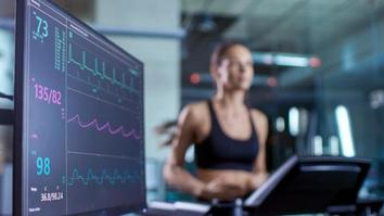 Medical monitor showing EKG reading of an athlete on a treadmill